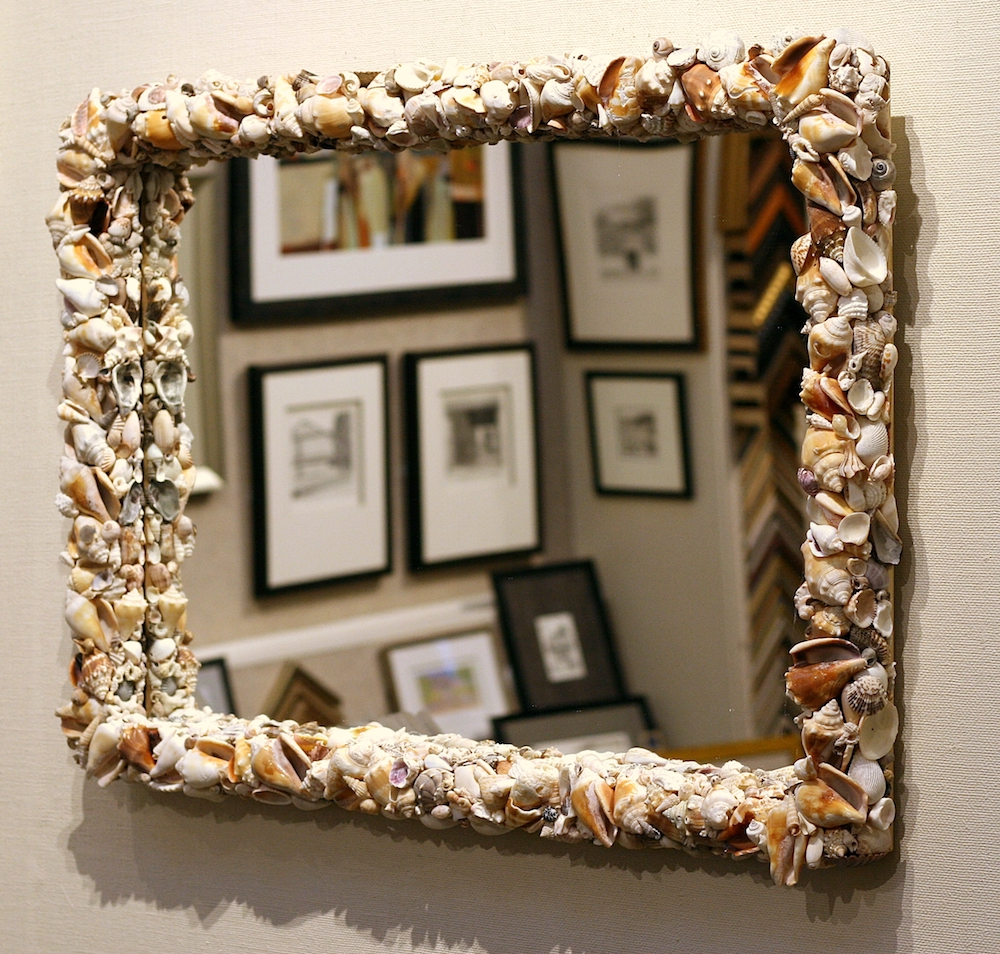 mirror with a shell frame